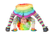 Little boy in clown dress somersault isolated on white — Stock Photo