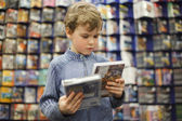 Young boy in special store — Stock Photo
