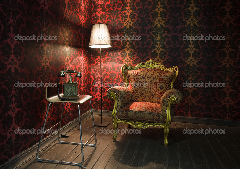 Corner of the room with red wallpaper, floor lamp and armchair. Old phone on the chair — Stock Photo #7936183