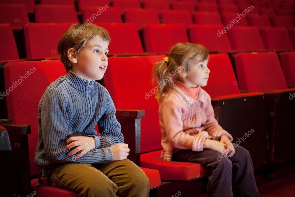 http://static7.depositphotos.com/1000998/793/i/950/depositphotos_7936349-Boy-and-little-girl-sitting-on-armchairs-at-cinema.jpg
