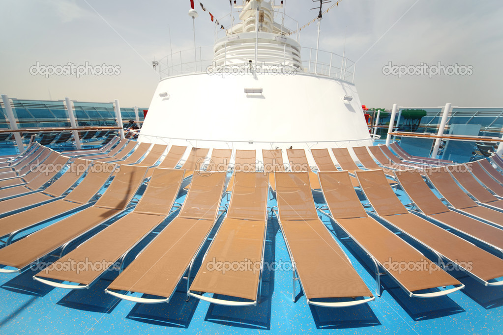 Brown beach chairs on blue ship deck summer day — Stock Photo #7936522