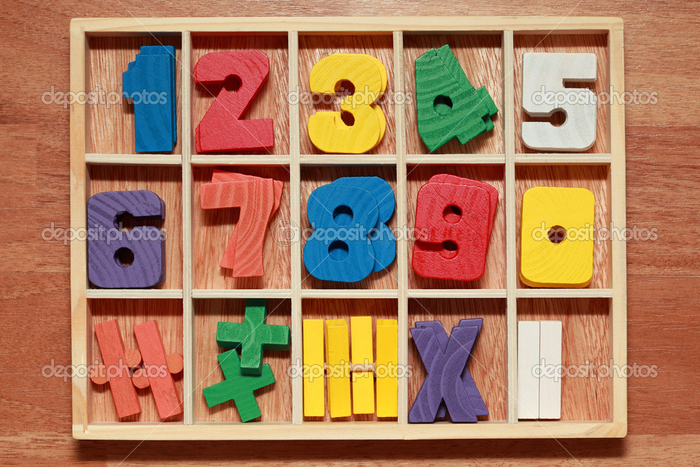 Math game for junior age with colored wooden signs of numbers — Stock Photo #7936768