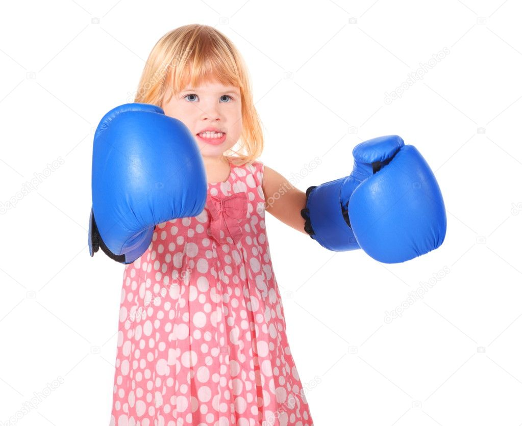 Little girl with bared teeth wearing dress and boxers gloves is standing. isolated. — Stock Photo #7937818
