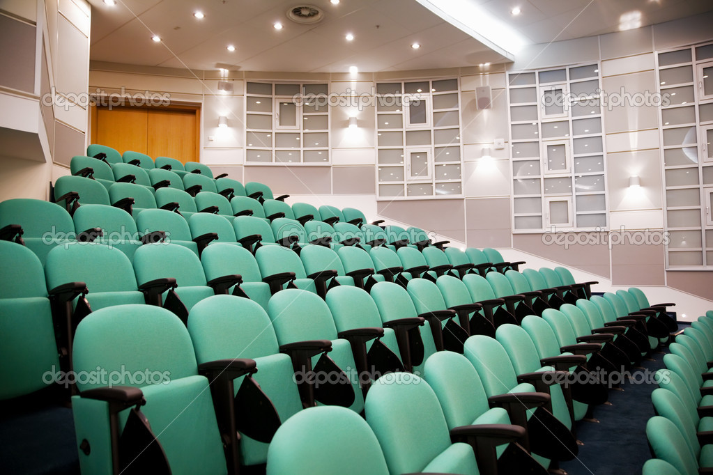 Empty conference hall, rows of a chairs, eight numbers in shot  Stock Photo #7938810