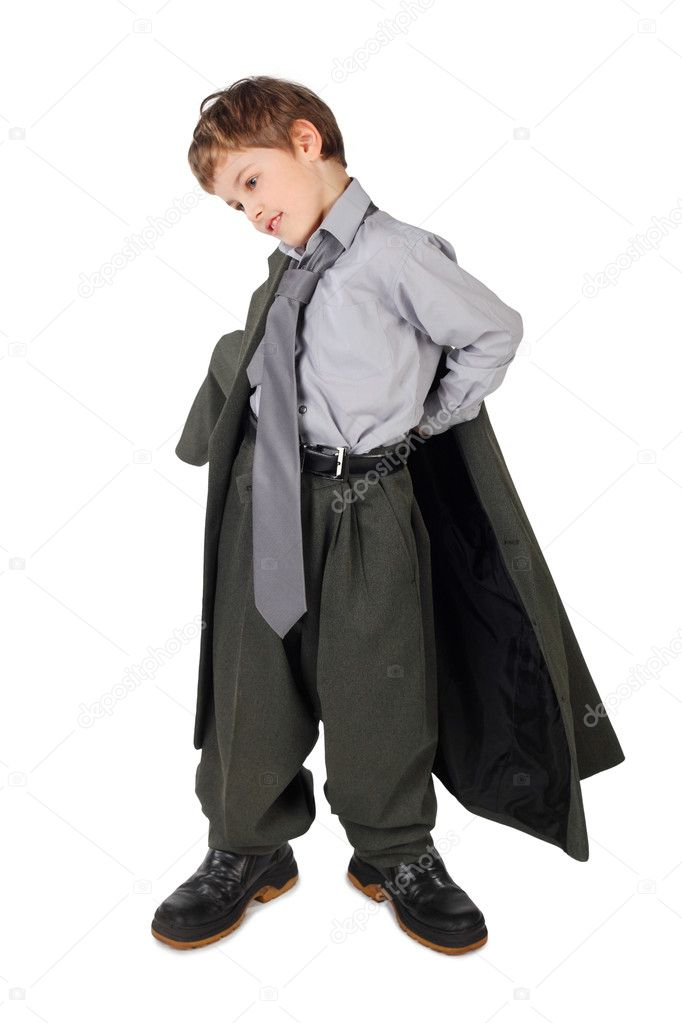 Little boy in big grey man's suit and boots dressing jacket isolated on white background — Stock Photo #7938885