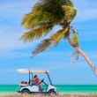 Golf cart at tropical beach - Stock Photo