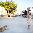 Girl and dog at town — Stock Photo