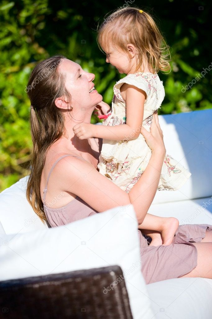 Happy young mother and daughter outdoors laughing — Stockfoto #6935082