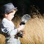 Boy with retro camera — Stock Photo