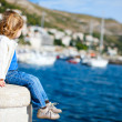 Little girl enjoying sea view — Stock Photo #7499207