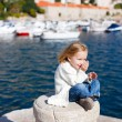 Little girl enjoying sea view — Stock Photo