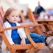 Little girl at outdoor cafe - Stock Photo