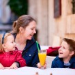 family at outdoor cafe — Stock Photo