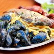 Seafood and french fries - Stockfoto