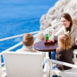 Family at seafront cafe — Stock Photo