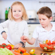 Two little kids making salad — Stock Photo