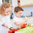 Two little kids making salad — Stock Photo #7809737