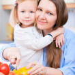 Mother and daughter at kitchen - Stock Photo