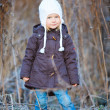 Little girl outdoors on winter day — Stock Photo #7809917