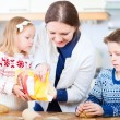 Family baking cookies — Stock Photo