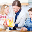 Family baking cookies — Stock Photo #7907717