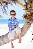 Little boy sitting on palm — Stock Photo