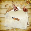 Wooden background with butterflies and envelope with space for text or phot - Stok fotoğraf