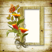 Wooden background with a frame for a photo and a bouquet — Stock Photo