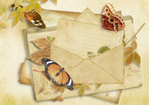 Vintage paper background with butterflies and envelope — Stock Photo