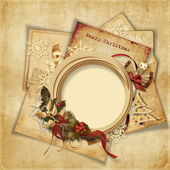 Christmas greeting background with old card and frame — Stock Photo
