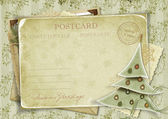Vintage background with postcard and Christmas tree — Stock Photo
