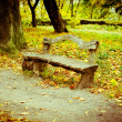 Royalty-Free Stock Photo: Old wooden bench in the autumn park