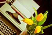 Retro postcard with typewriter and tulips — Stock Photo