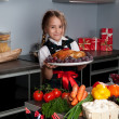 Little girl in the kitchen — Stock Photo #7564395