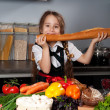 The little girl in the kitchen — Stock Photo #7564435