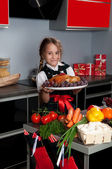 Little girl in the kitchen — Stock Photo
