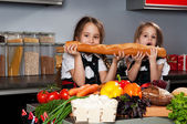 Two little girl in the kitchen — Stock Photo