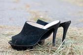 Black women shoes from shammy leather — Stock Photo