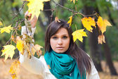 Beautiful woman in white coat and scarf — Stock Photo