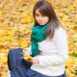 Beautiful woman with yellow leaf — Stock Photo