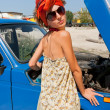 Vintage girl posing in front of the car — Stock Photo #7673243