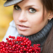 Beautiful woman portrait with viburnum berries — Stock Photo