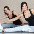 Stock Photo: Young women doing fitness exercises