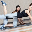 Young women doing fitness exercises — Stock Photo