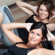 Stock Photo: Young beautiful fitness women stretching
