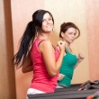 Stock Photo: Young women on a running simulator
