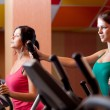 Young women in gym on stepper machine — Stock Photo #6806257