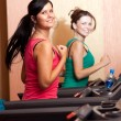 Royalty-Free Stock Photo: Young women on a running simulator