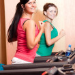 Young women on a running simulator — Stock Photo