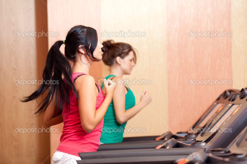 Young women on a running simulator  Stock Photo #6806251